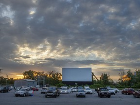 People wait for the start of the movie at the re-opening of the St-Eustache Drive-In amid the COVID-19 pandemic, Friday, June 5, 2020 in St-Eustache, Que.THE CANADIAN PRESS/Ryan Remiorz