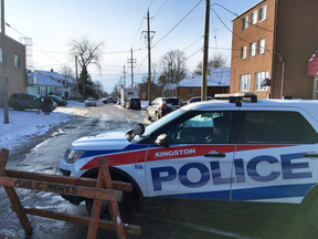 Police block off a street Friday morning during an RCMP national security investigation in Kingston, Ont. on Jan. 25, 2019.