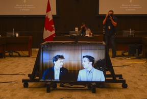 WE co-founders Marc Kielburger, left, and Craig Kielburger appear as witnesses via videoconference during a House of Commons finance committee hearing on July 28, 2020.