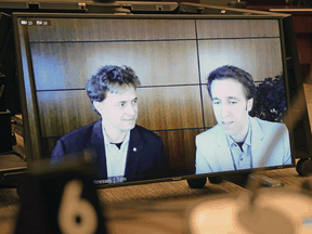 Marc, left, and Craig Kielburger appear as witnesses via videoconference during a House of Commons finance committee meeting in Ottawa on Tuesday.
