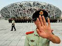 Chinese police patrol outside the Olympic Stadium in Beijing on July 21, 2008. Canada seems perfectly prepared to send its athletes to a sporting competition in a country where two of its citizens are held in state custody.