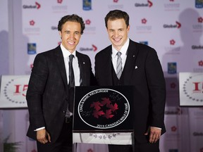 Free The Children co-founders Craig Kielburger, left, and Marc Kielburger, right, pose for a photo during their induction ceremony into Canada's Walk of Fame in Toronto on Saturday, September 21, 2013.