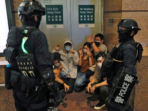 People detained by riot police during a march against national security law at the anniversary of Hong Kong's handover to China from Britain in Hong Kong, China July 1, 2020.