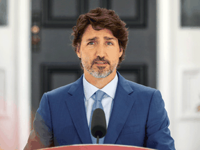 Prime Minister Justin Trudeau speaks to reporters at Rideau Cottage in Ottawa, July 13, 2020.
