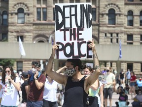 Protesters call for the defunding of police forces, at a downtown Toronto rally on June 28, 2020.