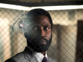 John David Washington in Tenet. If it opens, is it worth taking a coronaviral bullet to see?
