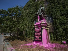 The vandalized statue of Egerton Ryerson on the Ryerson University campus in Toronto.