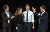 Co-founders Craig, left, and Marc Kielburger introduce Prime Minister Justin Trudeau and his wife Sophie Gregoire-Trudeau at WE Day in Ottawa, Nov. 10, 2015.