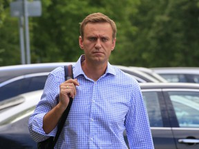 Russian opposition leader Alexei Navalny, who is charged with participation in an unauthorised protest rally, walks before a court hearing in Moscow, Russia July 1, 2019.