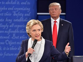 Republican presidential candidate Donald Trump listens to Democratic presidential candidate Hillary Clinton during a debate at Washington University in St. Louis, Missouri on Oct. 9, 2016.