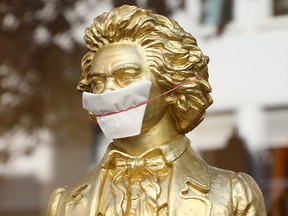 A bust of Ludwig van Beethoven is seen wearing a handmade face mask in the streets of Bonn, Germany, on April 8, 2020, during the coronavirus pandemic.