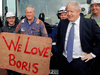 Britain's Prime Minister Boris Johnson stands with working class supporters during a campaign in Middlesbrough, England on November 20, 2019.