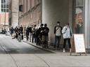 People line up outside a public clinic to get a COVID-19 test in Toronto on September 10. The very idea of private testing sites during the greatest public health crisis of our generation is unsettling to some.
