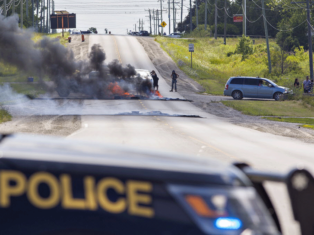 With new arrests at First Nations land occupation in Caledonia, comes echoes of fiery 2006 dispute