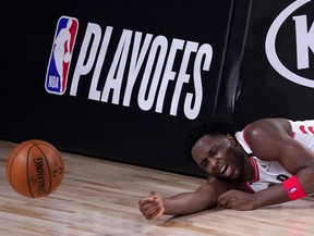 Toronto Raptors' OG Anunoby reacts after hitting the stanchion hard after being fouled by Boston Celtics' Daniel Theis on a breakaway shot during the second half of an NBA conference semifinal playoff basketball game Friday, Sept. 11, 2020, in Lake Buena Vista, Fla.