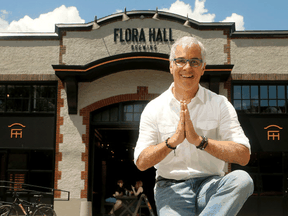 """David Longbottom in front of Flora Hall Brewing in downtown Ottawa in 2018. He says he has never encountered anything as """"complex or expensive"""" as trading beer across provincial borders in Canada."""