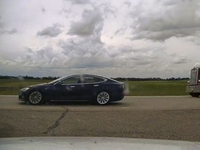 On July 9, Alberta RCMP pulled over a 2019 Tesla Model S on Highway 2 near Ponoka, that was travelling at speeds up to 150 km/h and appeared to be self-driving with both seats reclined and two people inside the car sleeping. Image supplied by Alberta RCMP.