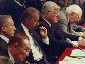 Sen. Joe Biden and Sen. Ted Kennedy attend the confirmation hearing for Supreme Court nominee Judge Ruth Bader Ginsburg before the Senate Judiciary Committee on Capitol Hill in Washington, in 1993.