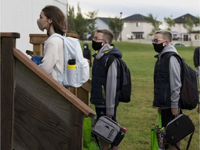 Teachers greet students al Archbishop Joesph MacNeil Catholic School on the first day of school, amid the COVID-19 pandemic, on Wednesday, Sept. 2, 2020.