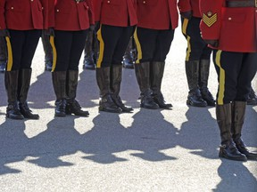 RCMP officers line up before a memorial for fallen mounties at RCMP Depot in Regina, Sask., on Sunday, Sept. 13, 2015. The Alberta government is looking to hire a contractor and an executive manager for a proposed provincial police force that would replace the RCMP.