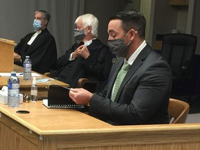 Police officer Carl Douglas Snelgrove (right) takes the stand at his sexual assault trial in St.John's, Tuesday, Sept.22, 2020.