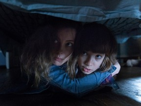 Under the bed? Good a place as any, I guess. Gillian Jacobs and Azhy Robertson in Come Play.