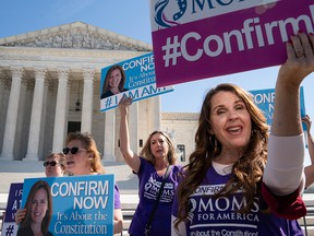 Supporters of U.S. Supreme Court nominee Judge Amy Coney Barrett demonstrate outside the Supreme Court as the Senate Judiciary Committee continues to consider Barrett's nomination on Capitol Hill on Oct. 15, 2020, in Washington, D.C.