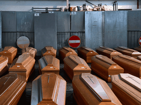 Coffins of holding victims of COVID-19 victims at a warehouse in Ponte San Pietro, Lombardy, on March 26, 2020 during the country's lockdown.