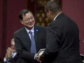 Scientist Ke Wu receives the Marie-Victorin award during a Prix du Quebec award ceremony Tuesday, November 4, 2014 at the National Assembly in Quebec City.