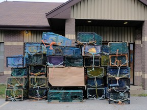 Lobster traps belonging to fishermen of the Sipekne'katik band are seen dumped at the DFO office in Meteghan. PHOTO BY TED PRITCHARD/REUTERS