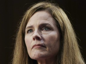 Amy Coney Barrett, U.S. President Donald Trump's nominee for associate justice of the U.S. Supreme Court, listens during a Senate Judiciary Committee confirmation hearing in Washington, D.C., U.S., on Monday, Oct. 12, 2020.