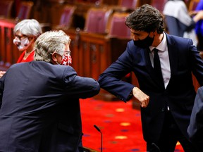 Prime Minister Justin Trudeau greets a Senator with an elbow-bump prior to the delivery of the throne speech in the Senate on Sept. 23, 2020.