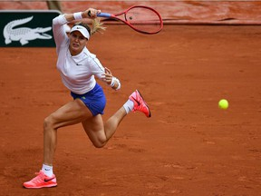 Canada's Eugenie Bouchard returns the ball to Poland's Iga Swiatek during their women's singles third round tennis match on Day 6 of The Roland Garros 2020 French Open tennis tournament in Paris on October 2, 2020.