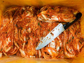 Seasoned kimchi and a knife sit inside a crate on the production line at the Ogawon Co. organic kimchi factory in Yangpyeong, South Korea, on Wednesday, Sept. 2, 2015.