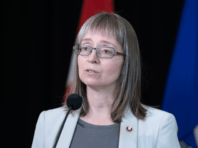 """Alberta's Chief Medical Officer of Health Dr. Deena Hinshaw on Thursday. """"We must reduce the growth of COVID-19 and we must do it soon,"""" she said."""