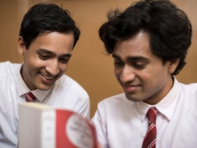 From left, Arjie and Shehan (Brandon Ingram, Rehan Mudannayake) share a love of books and more in Funny Boy.