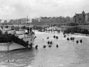 Canadian landing craft 299 delivers troops to Juno Beach, Courseilles-sur-Mer, France, on June 6, 1944.