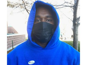 """Rapper Kanye West poses for a photo wearing the """"I voted"""" sticker, in Park County, Wyo., on Nov. 3."""