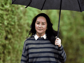 Huawei Technologies Chief Financial Officer Meng Wanzhou leaves her home to attend a court hearing in Vancouver on Nov. 23, 2020.