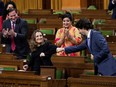Finance Minister Chrystia Freeland receives a fist-bump from Prime Minister Justin Trudeau after unveiling her first fiscal update, the Fall Economic Statement 2020, in the House of Commons, in Ottawa, on Nov. 30.