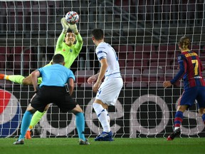 Kiev's Ukrainian goalkeeper Ruslan Neshcheret  makes a save during the UEFA Champions League group G football match between Barcelona and Dynamo Kiev at the Camp Nou stadium in Barcelona, on November 4, 2020.