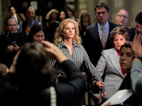 Summer Zervos, a former contestant on The Apprentice, leaves New York State Supreme Court with attorney Gloria Allred (R) after a hearing on the defamation case against U.S. President Donald Trump in Manhattan, New York City, U.S., December 5, 2017.