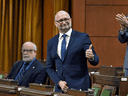Justice Minister David Lametti rises to vote in favour of a motion on Bill C-7, regarding medical assistance in dying, in the House of Commons on Thursday, Dec. 10, 2020.