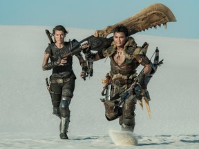 Hunting and gathering weapons: Milla Jovovich and Tony Jaa in Monster Hunter.