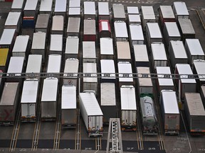 Freight lorries queue to board a ferry at the port of Dover on the south coast of England on December 18, 2020.