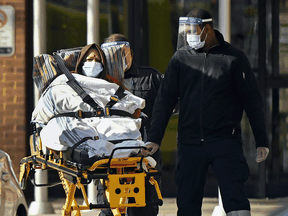 Paramedics take away a patient from Revera Westside Long Term Care Home in Toronto on Dec. 7, 2020.