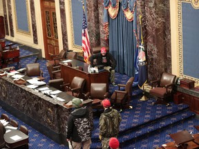 Protesters enter the Senate Chamber on January 06, 2021 in Washington, DC. Congress held a joint session today to ratify President-elect Joe Biden's 306-232 Electoral College win over President Donald Trump.
