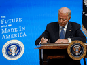 U.S. President Joe Biden signs an executive order related to American manufacturing at the White House on January 25, 2021 in Washington, DC.
