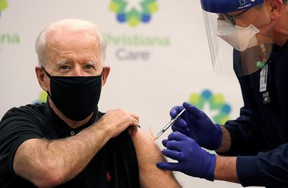 U.S. President-elect Joe Biden receives his second dose of a COVID vaccine at Christiana Hospital in Newark, Del., on Jan. 11, 2021.