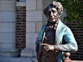 A statue of Sir John A. Macdonald, Canada's first prime minister, stands outside a library in Picton, Ont.